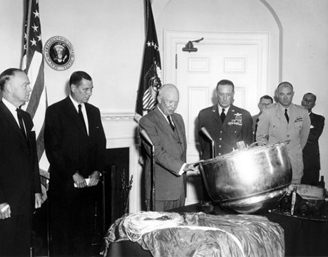 President Eisenhower inspects the capsule from Discover XIII